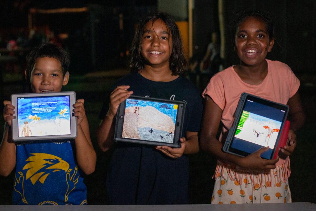 Nyikina children with Woonyoomboo multi-touch book